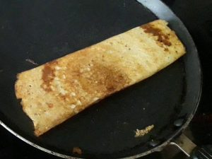 dosa is crispy and brown