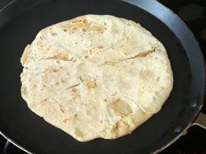 paratha little bit cooked from one side