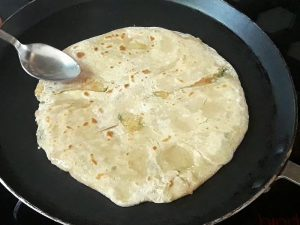 oil applied on another side of paratha