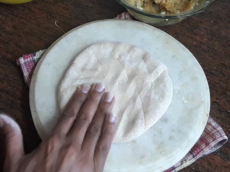 dough spread with the help of fingers