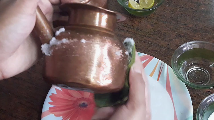 rubbing salt on copper vessel